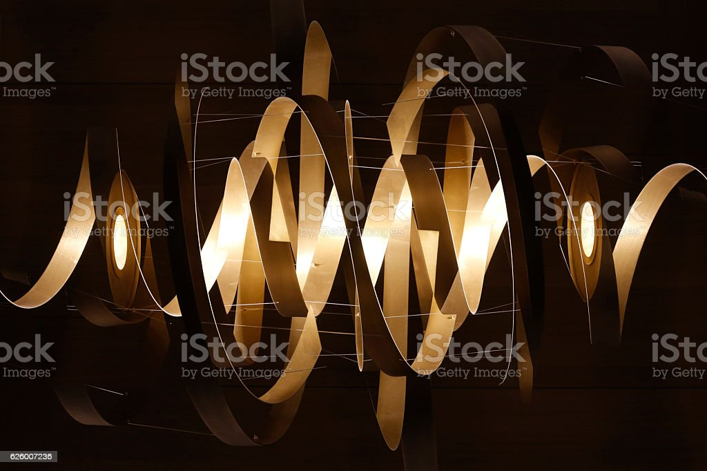 Lighting fixture with ribbon-shaped structure. Digitally rendered image stock photo