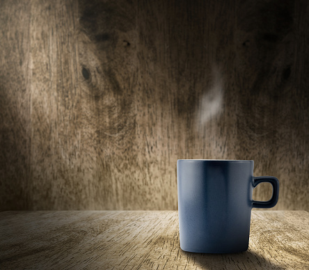 593305530 istock photo Lighting from window with blue coffee cup in wood room 480244186