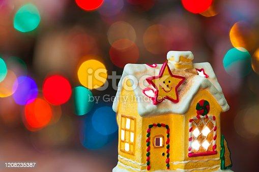 505891526istockphoto Lighting house and christmas tree 1208235387