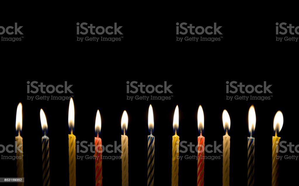 Lighting of birthday candle in the darkness stock photo