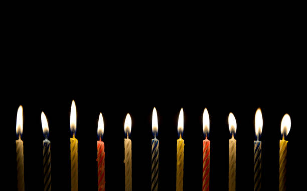 Lighting of birthday candle in the darkness Lighting of birthday candle in the darkness birthday candle stock pictures, royalty-free photos & images