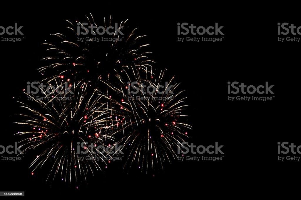 lighting of fireworks at night stock photo