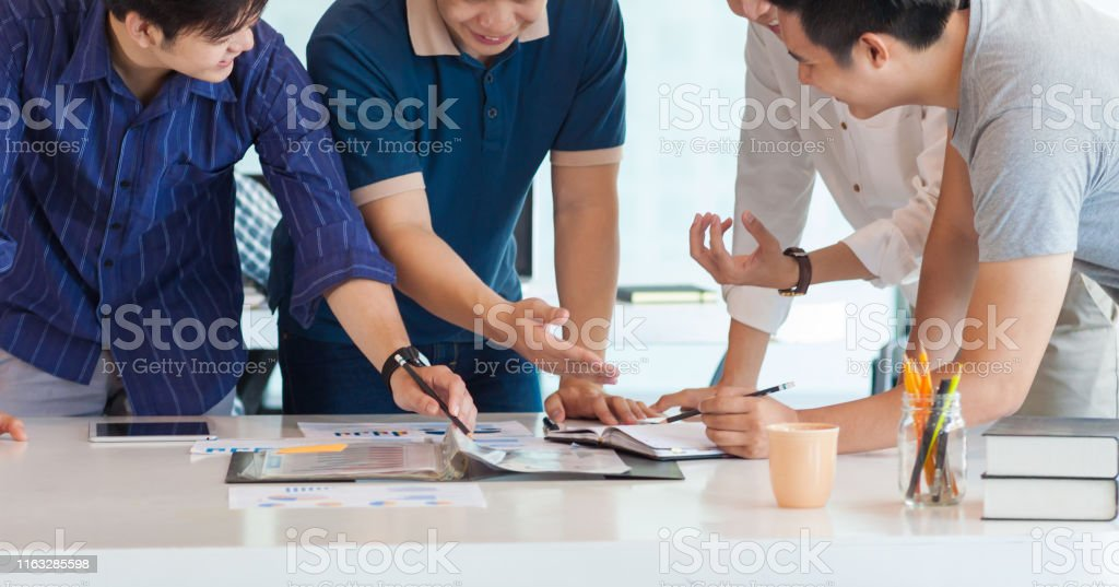 University students work together in academic projects. Students are...