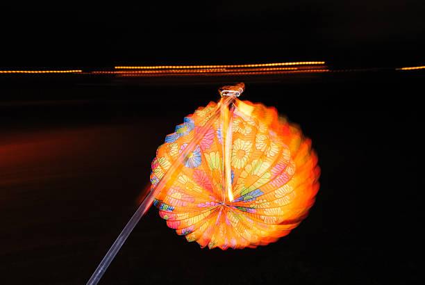 Lighting paper lantern in hand stock photo