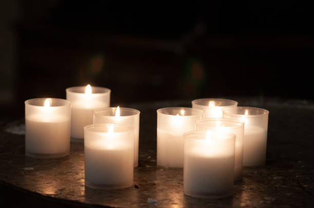Lighting Prayer Candles in a Church stock photo