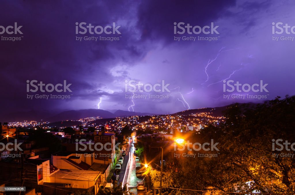 Lighting storm over a city stock photo