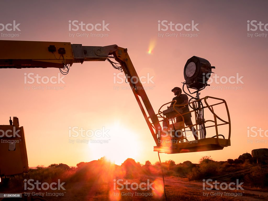 Lighting technician working on a shoot stock photo