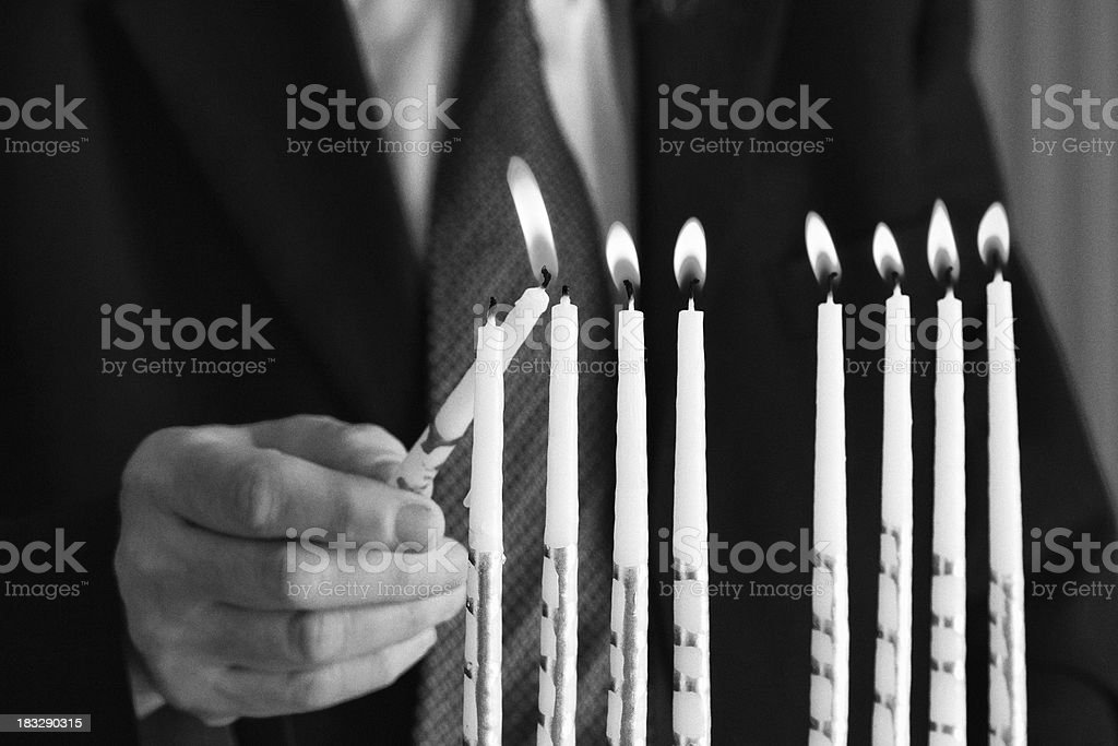 Lighting the Menorah royalty-free stock photo