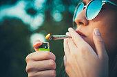 Lighting up marijuana cannabis joint