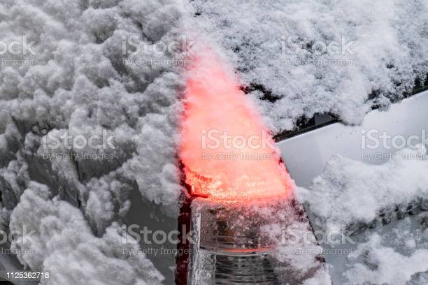 Photo of lightly covered with snow on a car