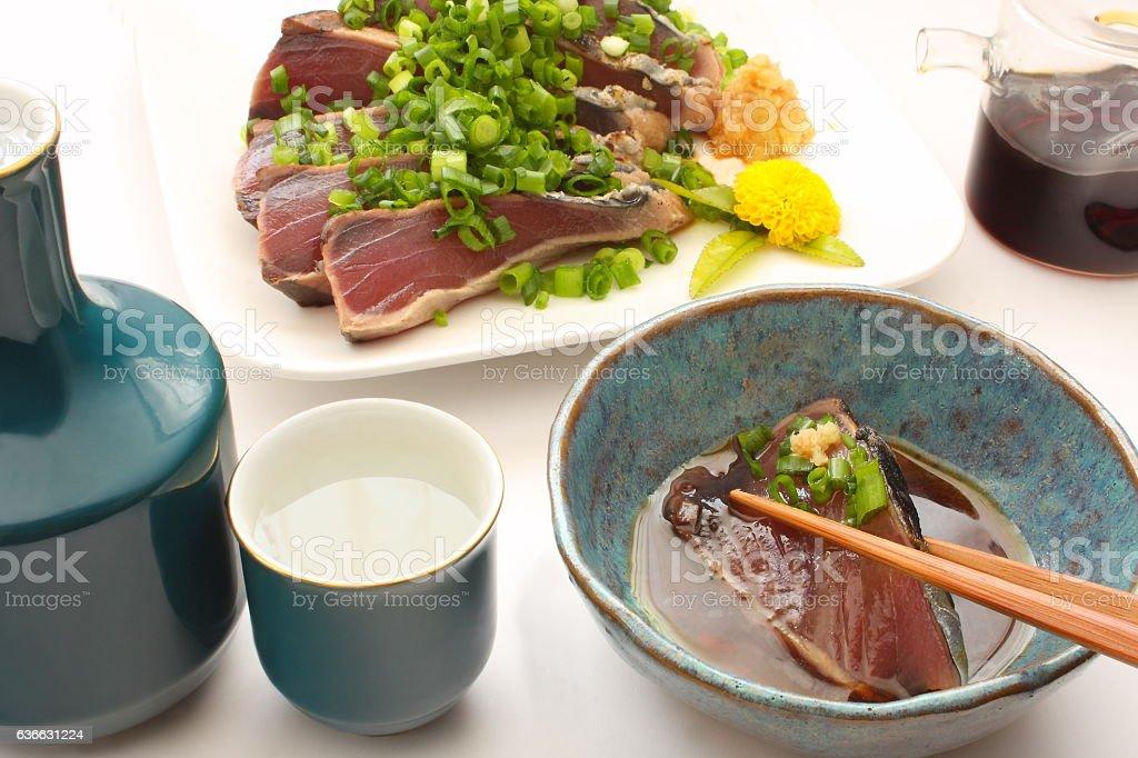Lightly Roasted Bonito Sashimi and rice wine Sake, Japanese food stock photo