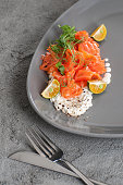 Lightly salted salmon with cottage cheese cream and limequat.