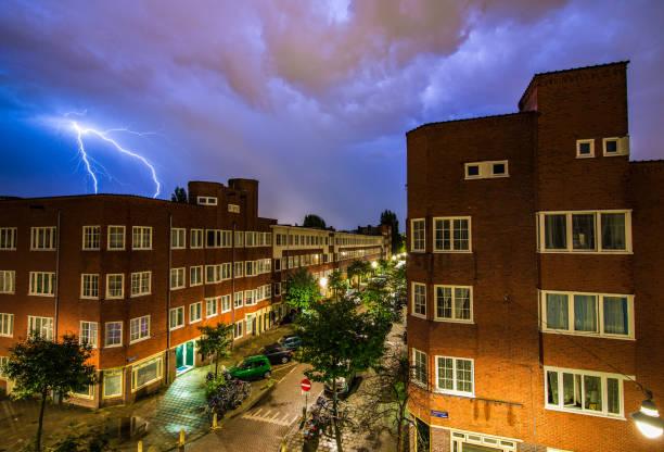 Lightning above houses in Amsterdam stock photo