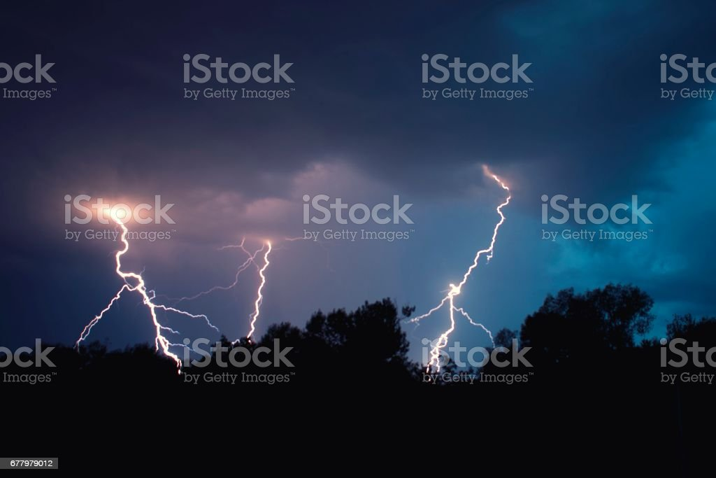 lightning and clouds in night landscape storm stock photo