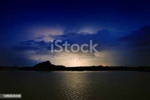 1159605033 istock photo Lightning at night over the lake 1086609456