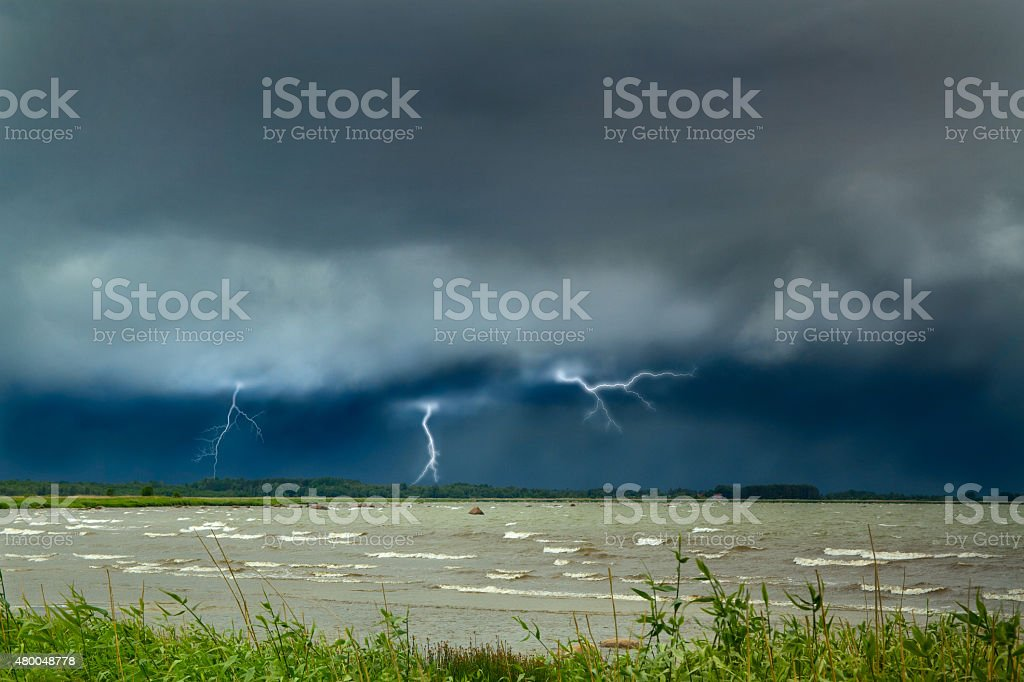 Lightning at sea. curtains on the coast. stock photo