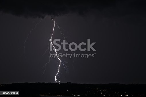 503731700 istock photo Lightning between clouds and earth 484588034