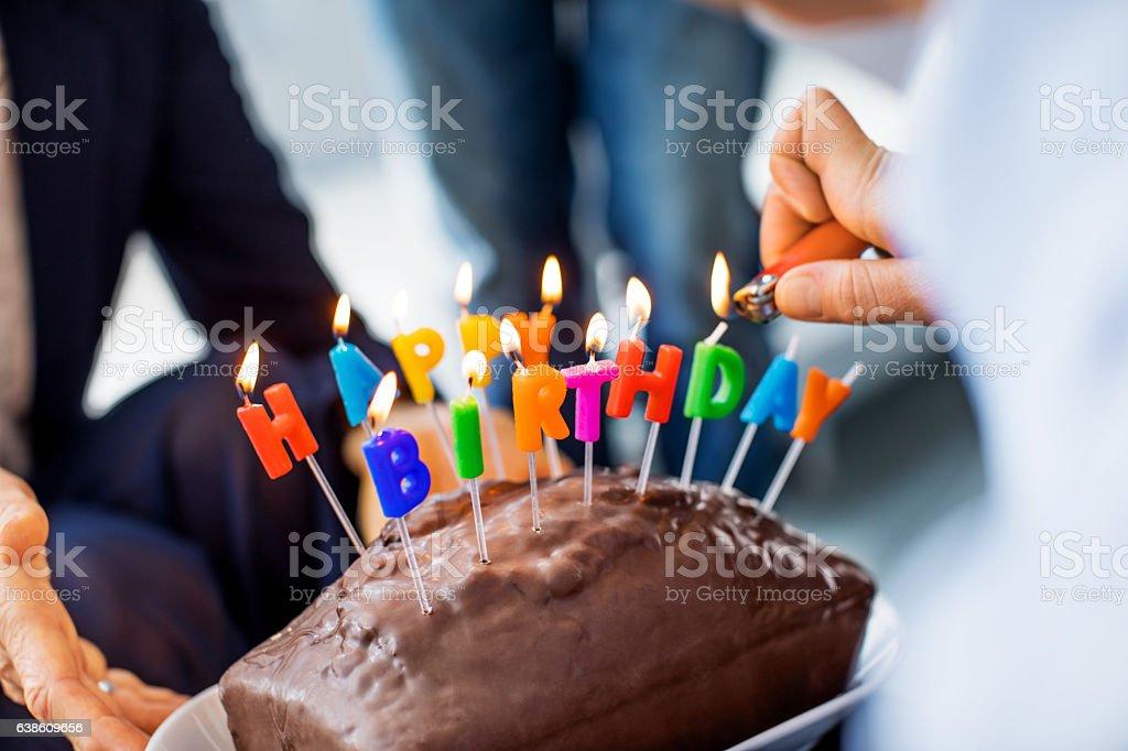 Lightning birthday candles on the cake - Photo