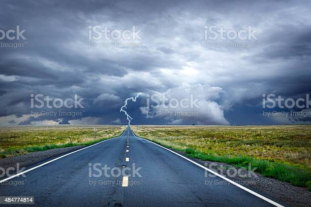 Photo of Lightning Bolt At The End Of Long Rural Road