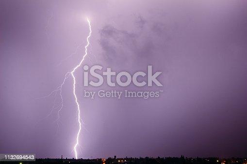 1144340539istockphoto Lightning bolt in a stormy sky 1132694543