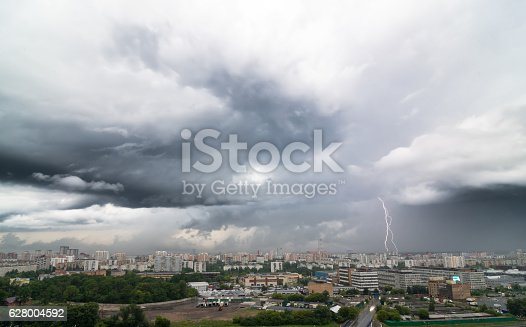 1155214300istockphoto Lightning bolt over city in stormy day. 628004592