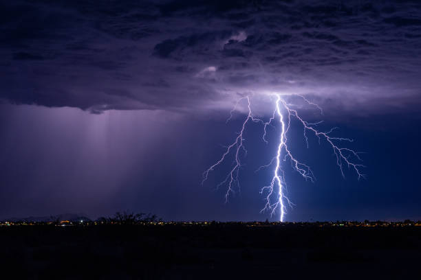 Lightning bolt strike from a storm. stock photo