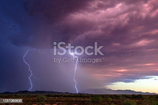 1039163636 istock photo Lightning bolt strikes from a thunderstorm 1257085835