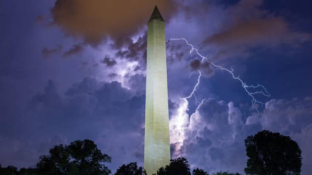 Lightning bolt strikes over the Washington Monument in D.C. stock photo