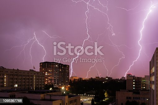 Lightning on the background of the night city
