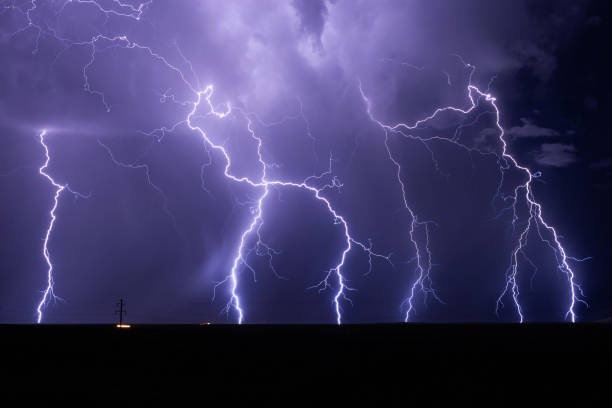 Lightning bolts strike from a powerful storm stock photo