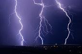 Lightning bolts strike the city of Congress, Arizona in a summer, monsoon storm.