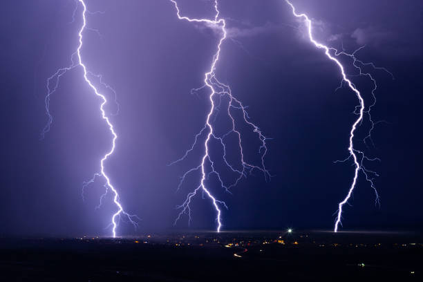 Lightning bolts strike in a summer storm. stock photo