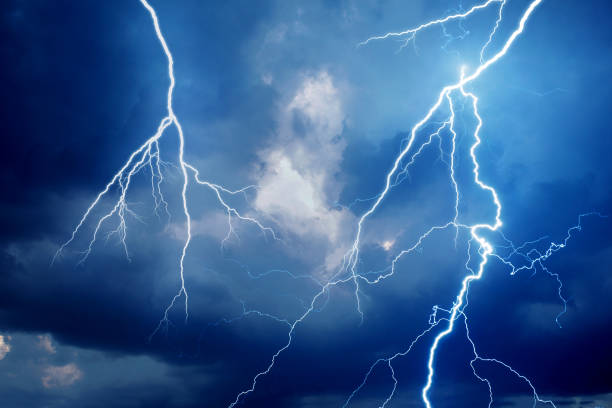 Lightning during storm at night stock photo