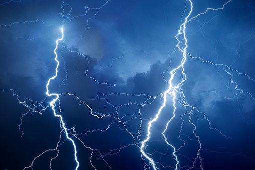 Summer storm bringing thunder, lightning and rain during night.