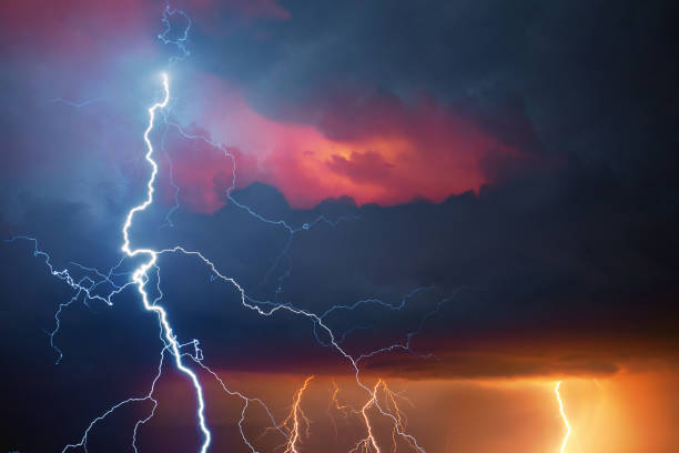 Lightning during summer storm stock photo