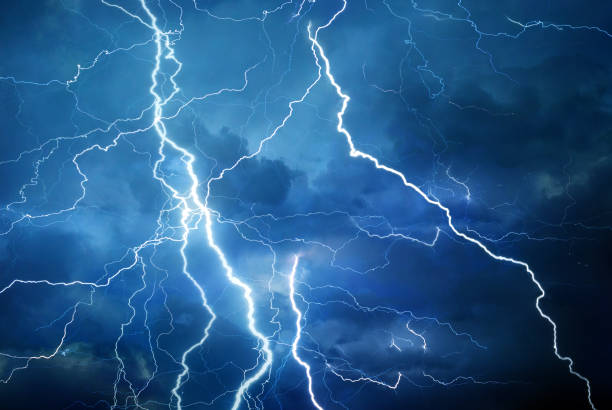 Lightning during summer storm Thunder, lightning and rain during summer storm at night. atmospheric mood stock pictures, royalty-free photos & images