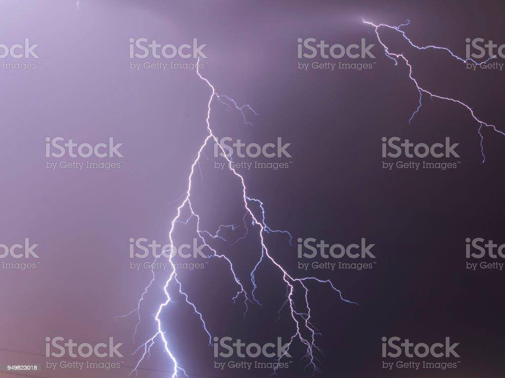 Lightning flash over a city, Thunderstorm , electricity blast storm,...