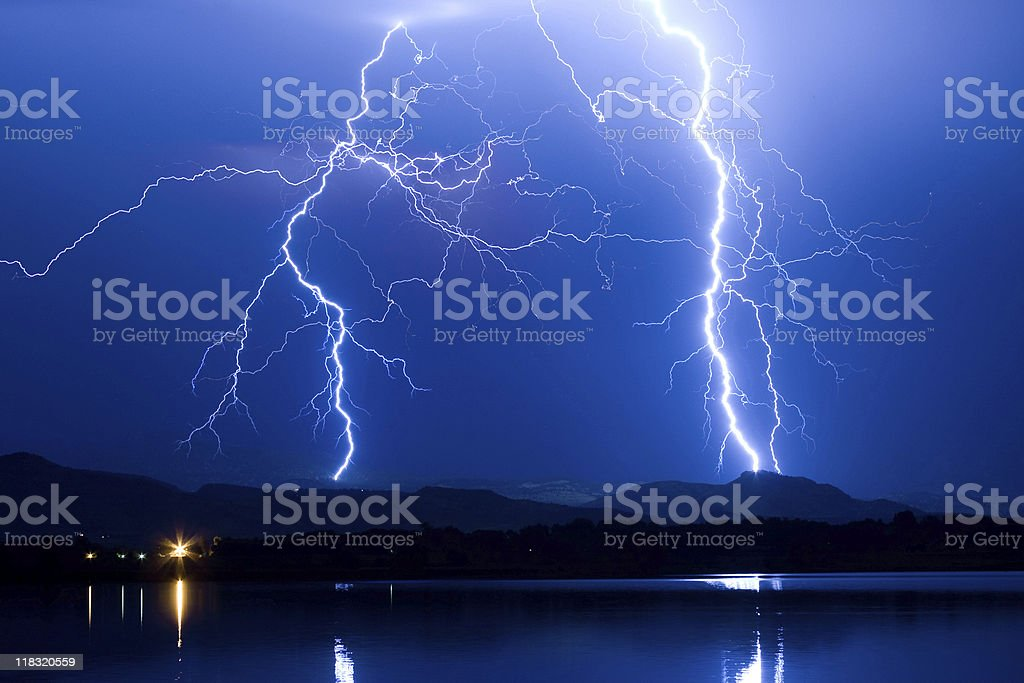 Lightning, hills and Lake royalty-free stock photo