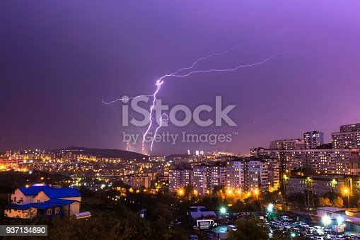 istock Lightning hitting the bridge during a purple sunset in the city 937134690