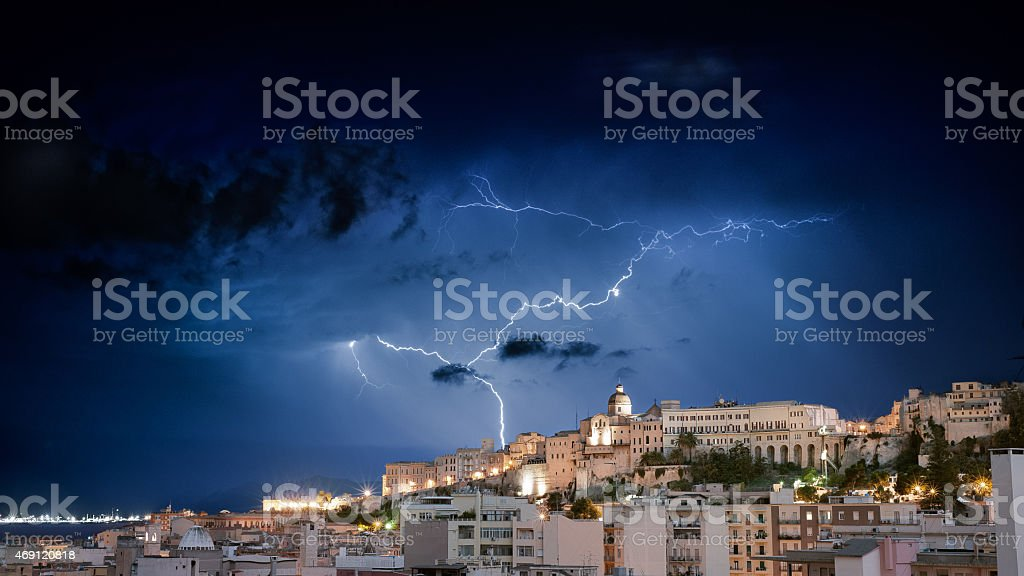 lightning in the city by night stock photo