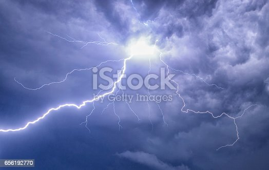 istock Lightning in the night sky during a thunderstorm 656192770
