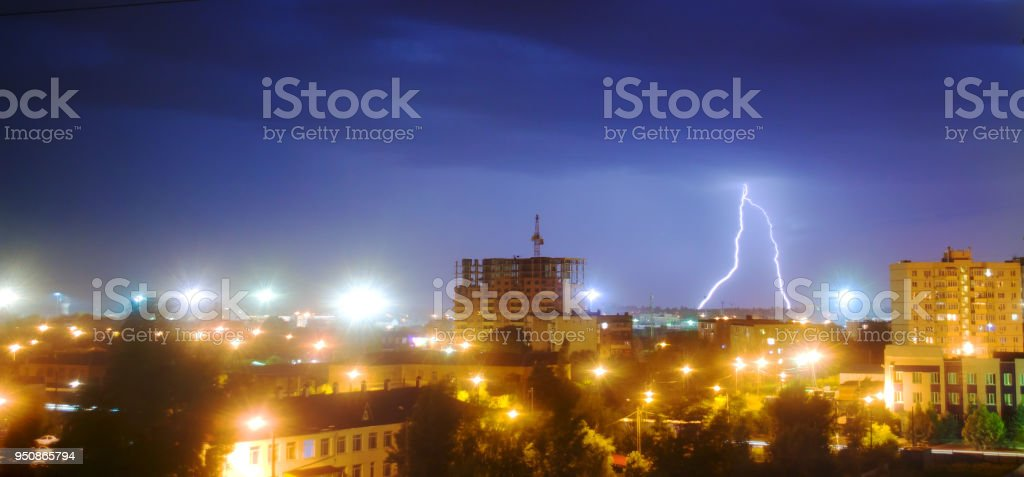 lightning in the night sky over the city. The flash of lightning...