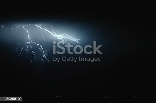 656192770istockphoto Lightning in the sky. Electric discharges in the sky 1080368102
