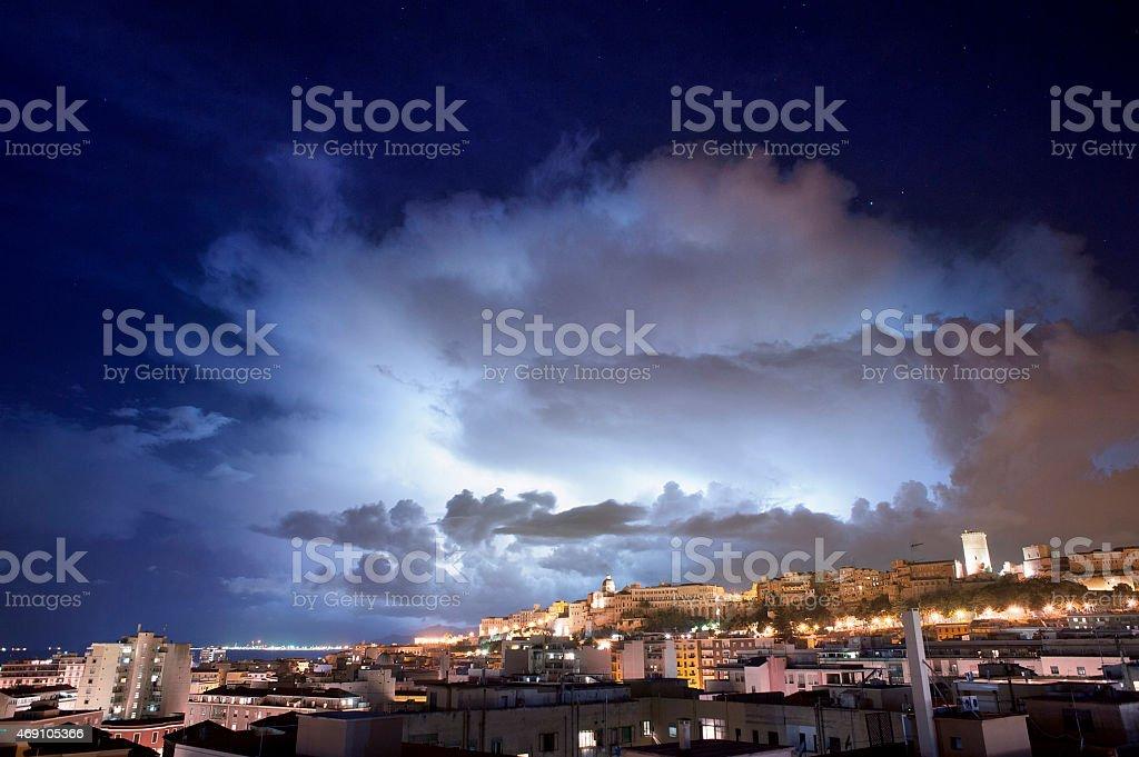 Lightning light inside the cloud stock photo