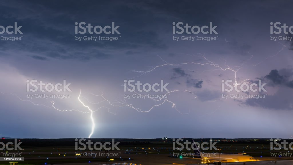 Lightning lights up the sky over Dulles International Airport stock photo