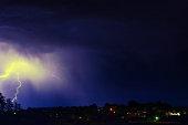 Forked lightning lights up the sky.