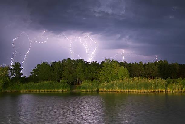Lightning on the river. stock photo