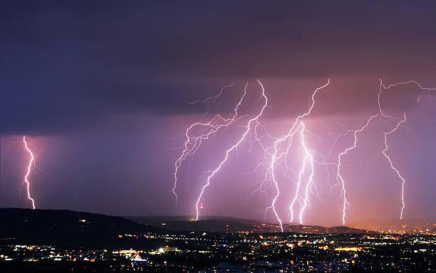 lightning over a city stock photo