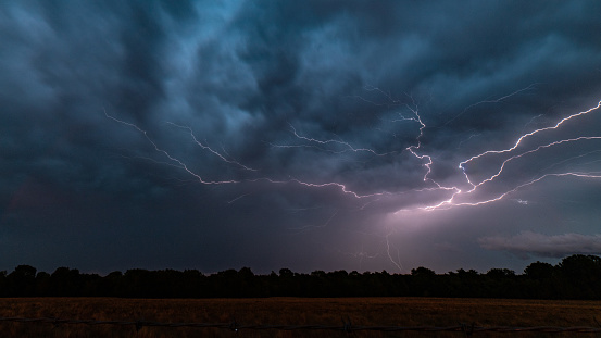 A bolt of lightning on the backside of a thunderstorm in College Station, Texas.