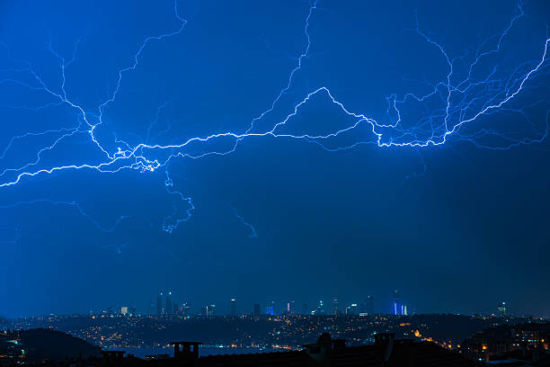 Lightning over Istanbul city during thunderstorm stock photo